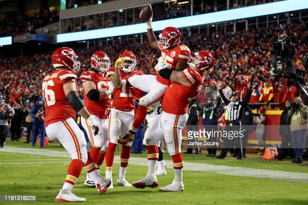 LeSean McCoy of the Kansas City Chiefs celebrates with his teammates after scoring a 3 yard touchdown during the third quarter in the game at...