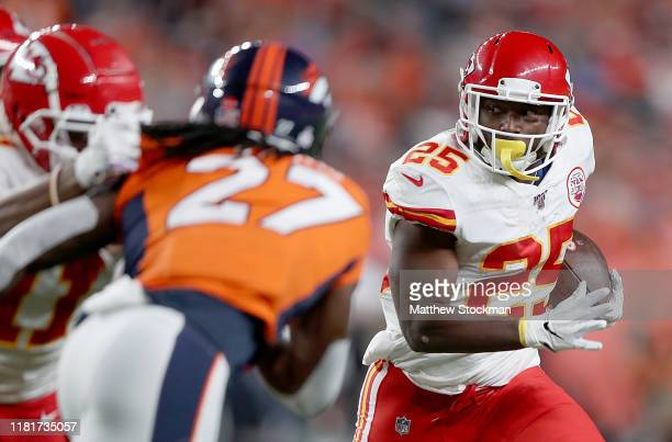 LeSean McCoy of the Kansas City Chiefs runs against the defense of the Denver Broncos in the game at Broncos Stadium at Mile High on October 17 2019...