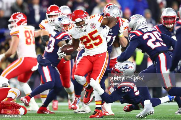 LeSean McCoy of the Kansas City Chiefs runs with the ball as Dont'a Hightower of the New England Patriots attempts to tackle him during the first...