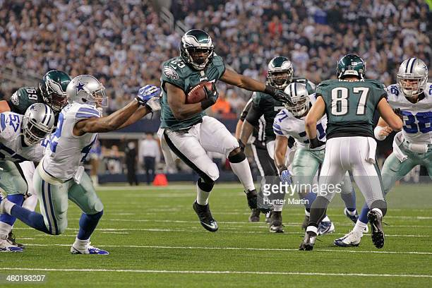 LeSean McCoy of the Philadelphia Eagles carries the ball during a game against the Dallas Cowboys on December 29 2013 at ATT Stadium in Dallas Texas...