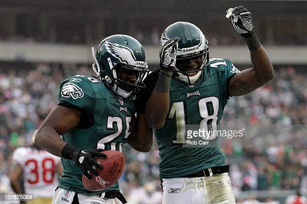 LeSean McCoy of the Philadelphia Eagles celebrates scoring a touchdown with teammate Jeremy Maclin against the San Francisco 49ers during the first...