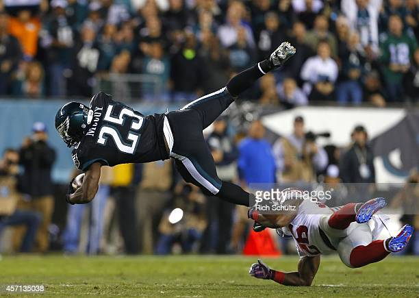 LeSean McCoy of the Philadelphia Eagles is hit by Antrel Rolle of the New York Giants after running for a first down during the first quarter in a...