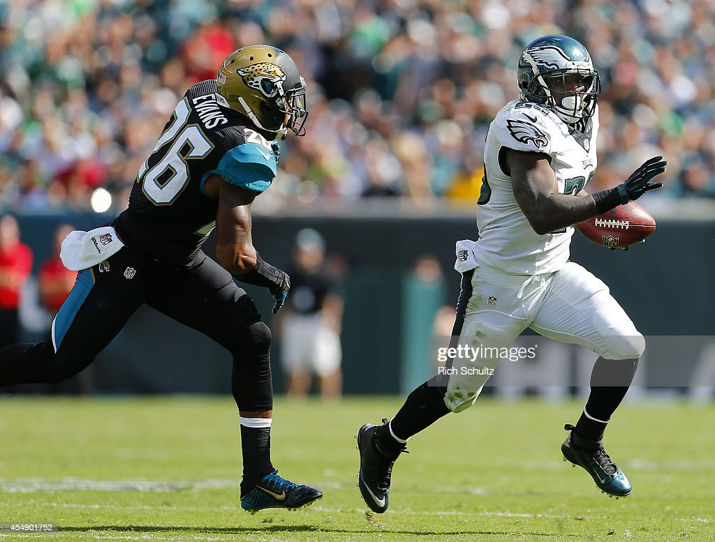 LeSean McCoy #25 of the Philadelphia Eagles outruns Josh Evans #26 of the Jacksonville Jaguars during the fourth quarter of a NFL game at Lincoln Financial Field on September 7, 2014 in Philadelphia, Pennsylvania. The Eagles defeated the Jaguars 34-17.