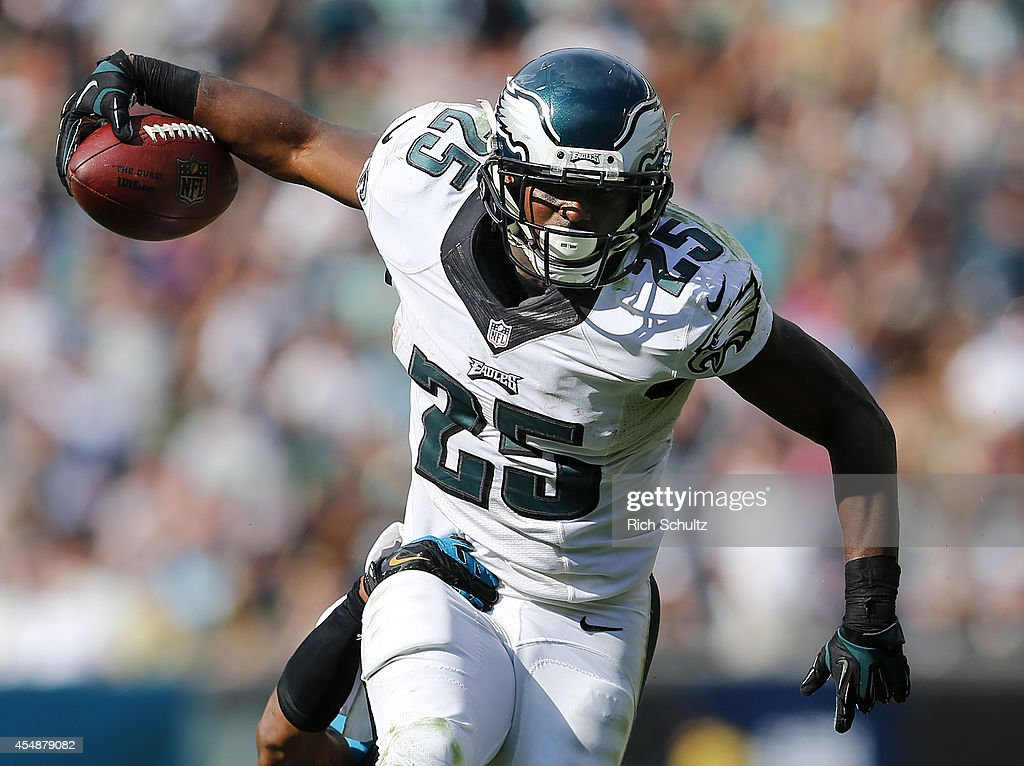 LeSean McCoy #25 of the Philadelphia Eagles runs for a first down as Josh Evans #26 of the Jacksonville Jaguars attempts a tackle during the fourth quarter of a NFL game at Lincoln Financial Field on September 7, 2014 in Philadelphia, Pennsylvania. The Eagles defeated the Jaguars 34-17.