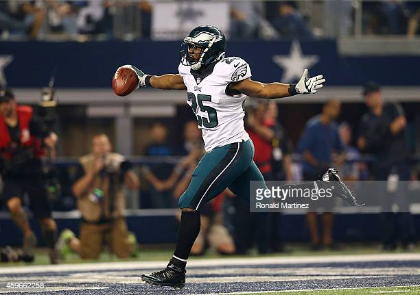 LeSean McCoy of the Philadelphia Eagles runs for a touchdown against the Dallas Cowboys in the second half at AT&T Stadium on November 27, 2014 in...