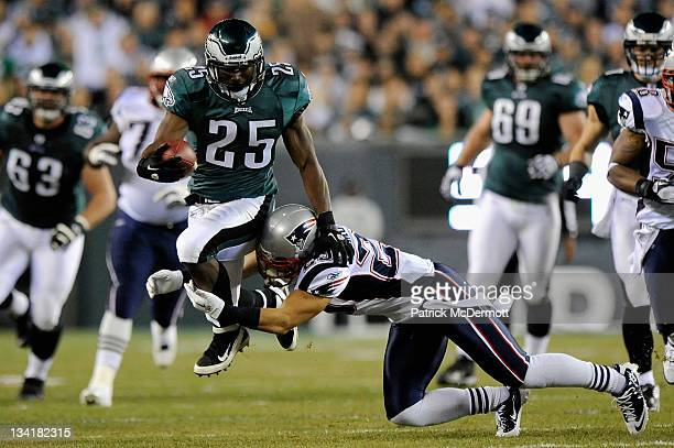 LeSean McCoy of the Philadelphia Eagles runs the ball in the second quarter against Sterling Moore of the New England Patriots at Lincoln Financial...