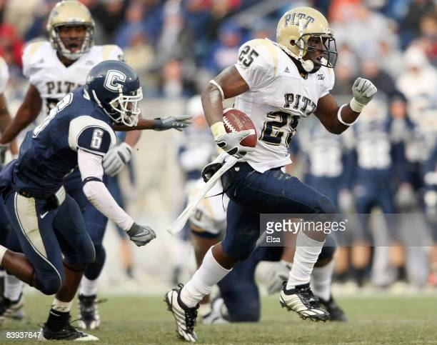 LeSean McCoy of the Pittsburgh Panthers breaks free from Jasper Howard of the Connecticut Huskies to carry the ball in for a touchdown on December 6...