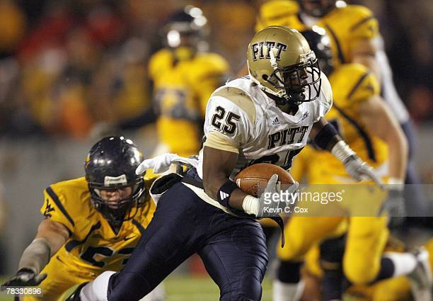 LeSean McCoy of the Pittsburgh Panthers carries the ball during the game against the West Virginia Mountaineers at Milan Puskar Stadium on December 1...