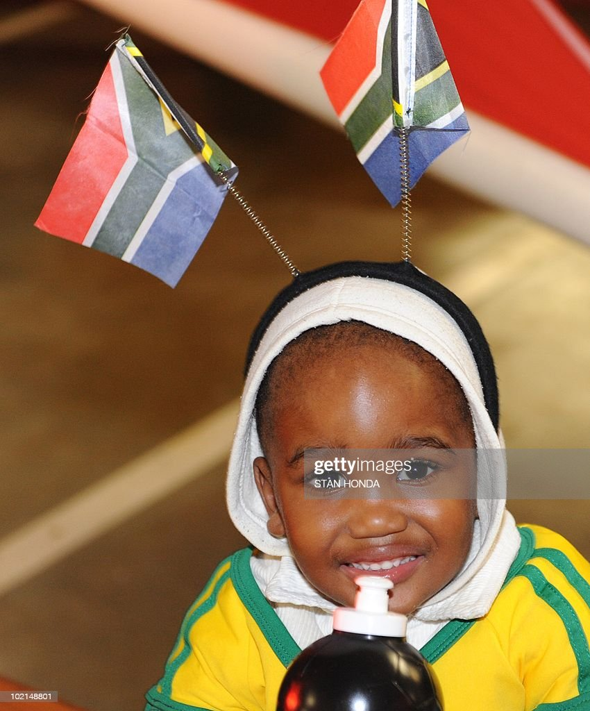 Lesedi Moleba wears two South African flags before watching the South Africa vs.Uruguay game at the Silverstar Casino in Muldersdrift on June 16, 2010 during the 2010 World Cup football tournament. AFP PHOTO/Stan Honda