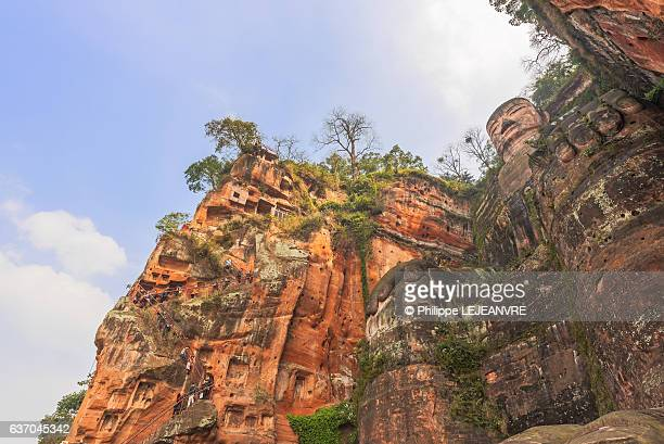 Leshan Giant Buddha against blue sky low angle view - China