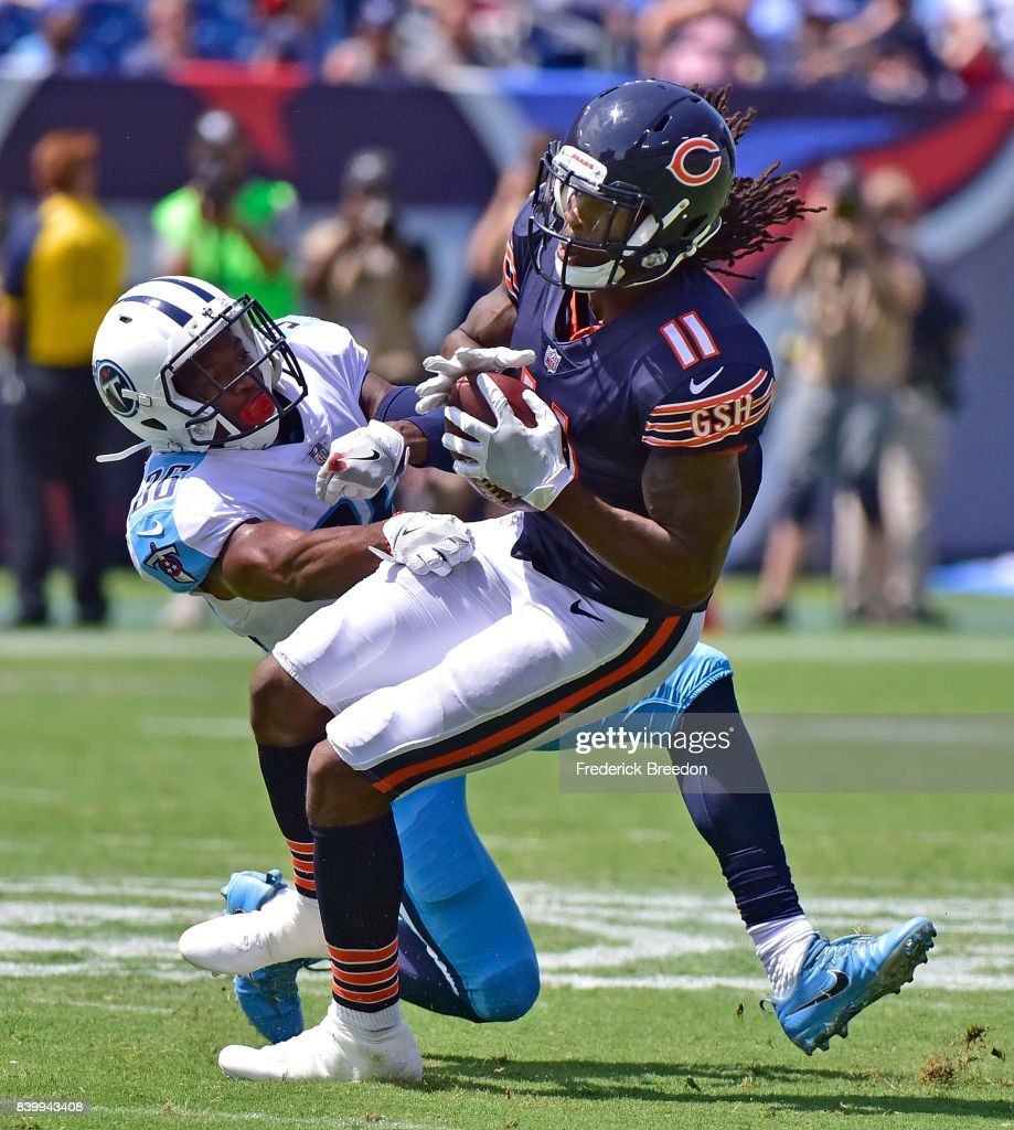 LeShaun Sims #36 of the Tennessee Titans tackles Kevin White #11 of the Chicago Bears during the first half at Nissan Stadium on August 27, 2017 in Nashville, Tennessee.