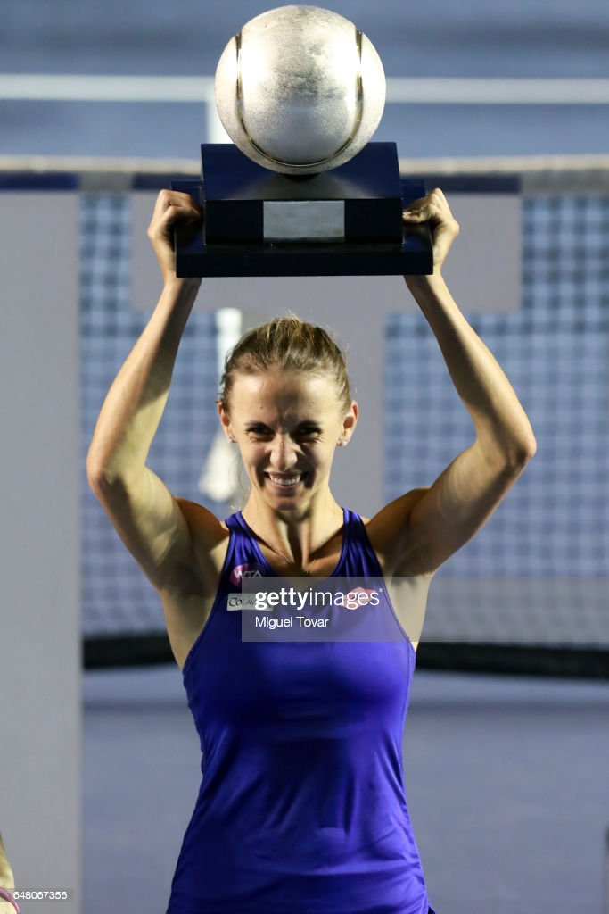 Lesia Tsurenko (UKR) celebrates with the champions trophy after winning the Final match between Lesia Tsurenko (UKR) and Kristina Mladenovic (FRA) as part of the Abierto Mexicano Telcel 2017 at the Fairmont Acapulco Princess on March 04, 2017 in Acapulco, Mexico.
