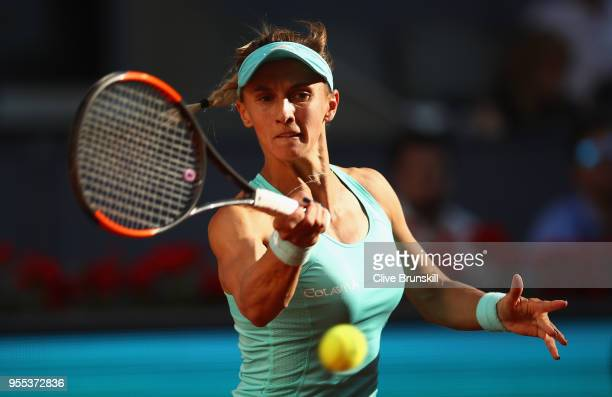 Lesia Tsurenko of the Ukraine plays a backhand against Petra Kvitova of the Czech Republic in their first round match during day two of the Mutua...