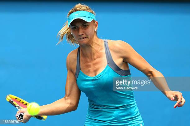 Lesia Tsurenko of the Ukraine plays a forehand in her second round match against Daniela Hantuchova of Slovakia during day three of the 2012...