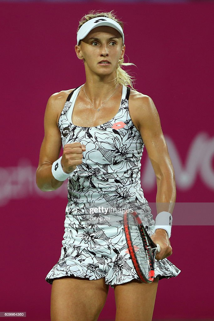 Lesia Tsurenko of Ukraine celebrates a point during the match against Anett Kontaveit of Estonia on Day 5 of WTA Guangzhou Open on September 23, 2016 in Guangzhou, China.