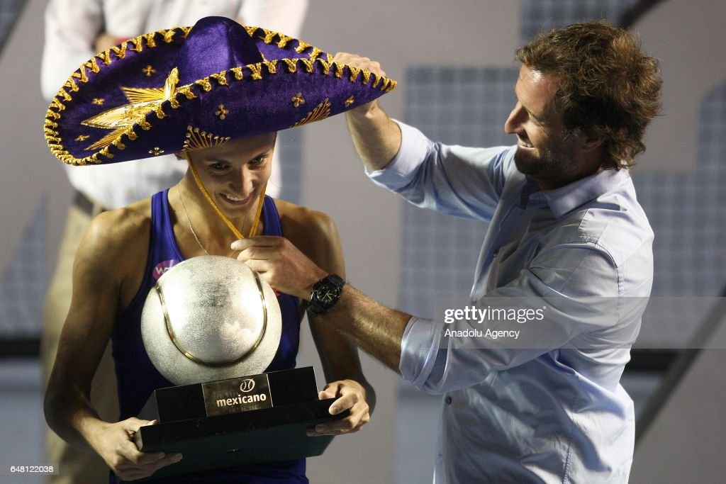 Lesia Tsurenko of Ukraine celebrates his victory against Kristina Mladenovic (not seen) of France with his trophy after the women's final match as part of the Mexican Open 2017 at the Fairmont Acapulco Princess on March 04, 2017 in Acapulco, Mexico.