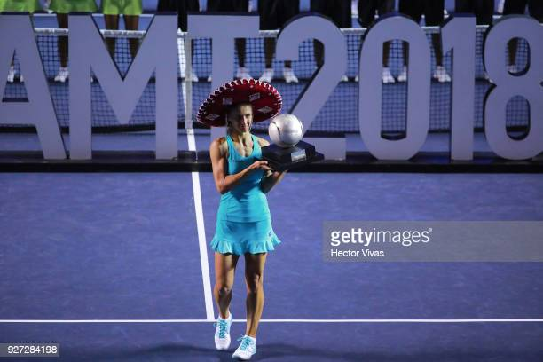 Lesia Tsurenko of Ukraine celebrates with the champion trophy after winning the Championship match between Stefanie Voegele of Switzerland and Lesia...