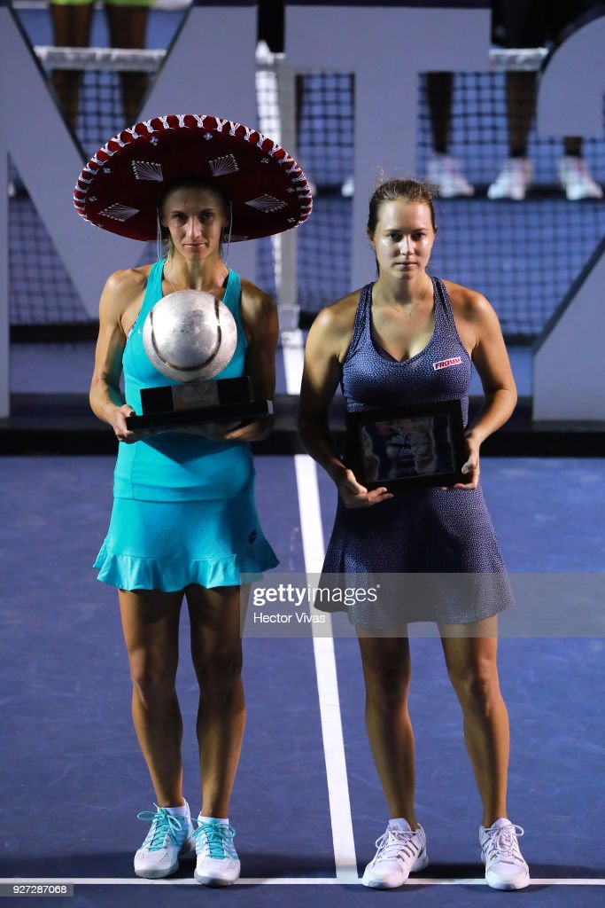 Lesia Tsurenko of Ukraine celebrates with the champion trophy while Stefanie Voegele of Switzerland poses with second place trophy after the Championship match between Stefanie Voegele of Switzerland and Lesia Tsurenko of Ukraine as part of the Telcel ATP Mexican Open 2018 at Mextenis Stadium on March 03, 2018 in Acapulco, Mexico.