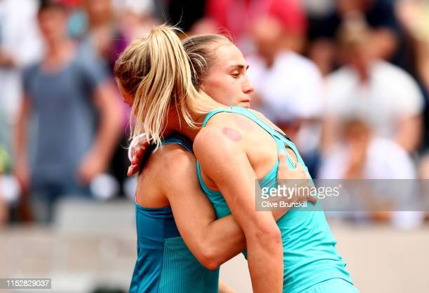 Lesia Tsurenko of Ukraine embraces Alexandra Krunic of Serbia following their ladies singles second round match during Day six of the 2019 French...
