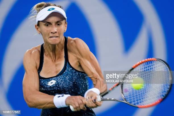 Lesia Tsurenko of Ukraine hits a return against Daria Kasatkina of Russia during their women's singles first round match of the WTA Wuhan Open tennis...