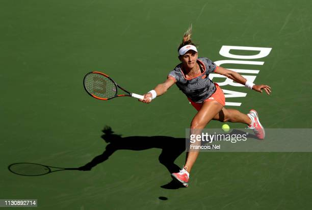 Lesia Tsurenko of Ukraine in action against Simona Halep of Romania during day four of the Dubai Duty Free Tennis Championships at Dubai Tennis...