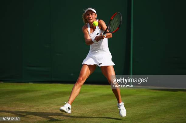 Lesia Tsurenko of Ukraine plays a backhand during the Ladies Singles first round match against Julia Georges of Germany on day two of the Wimbledon...