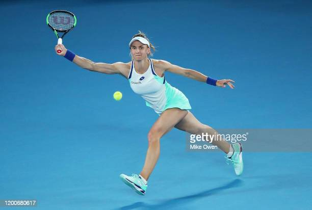 Lesia Tsurenko of Ukraine plays a forehand during her Women's Singles first round match against Ashleigh Barty of Australia on day one of the 2020...