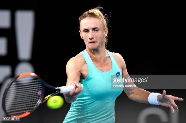 Lesia Tsurenko of Ukraine plays a forehand in her match against Ashleigh Barty of Australia during day two of the 2018 Brisbane International at Pat...