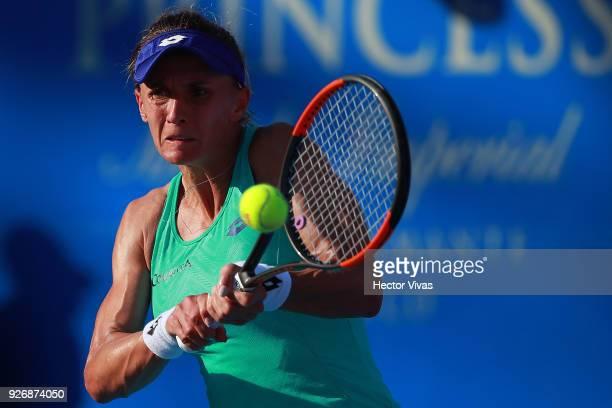 Lesia Tsurenko of Ukraine returns a shot during a semifinal match between Daria Gavrilova of Australia and Lesia Tsurenko of Ukraine as part of the...