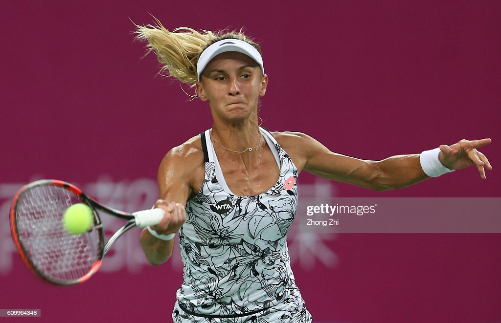 Lesia Tsurenko of Ukraine returns a shot during the match against Anett Kontaveit of Estonia on Day 5 of WTA Guangzhou Open on September 23, 2016 in Guangzhou, China.