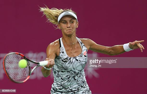 Lesia Tsurenko of Ukraine returns a shot during the match against Anett Kontaveit of Estonia on Day 5 of WTA Guangzhou Open on September 23 2016 in...