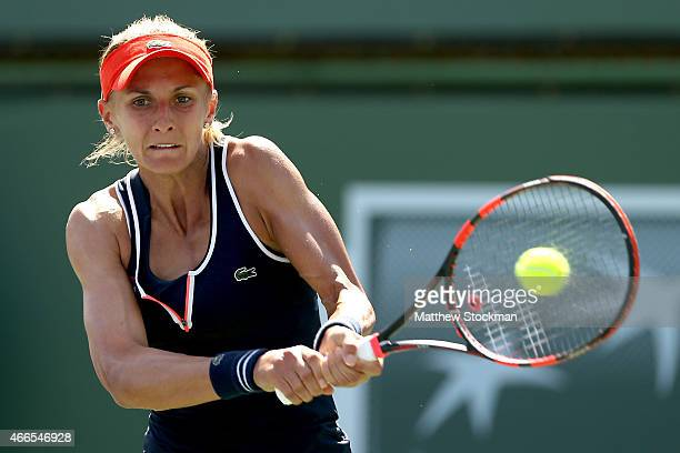 Lesia Tsurenko of Ukraine returns a shot to Alize Cornet of France during day eight of the BNP Paribas Open at the Indian Wells Tennis Garden on...