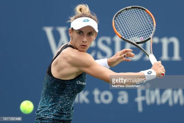 Lesia Tsurenko of Ukraine returns a shot to Garbine Muguruza of Spain during the Western Southern Open at Lindner Family Tennis Center on August 15...