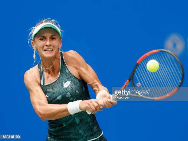 Lesia Tsurenko of Urkaine returns a shot to Carla Suarez Navarro of Spain in first round during Day 1 of 2017 Wuhan Open on September 24 2017 in...