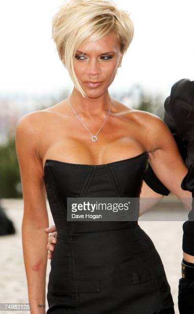 Lesion is visible on Victoria Beckham's right forearm as she poses for a photocall at the Royal Observatory, Greenwich ahead of a Spice Girls news...
