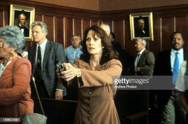 Lesley Ann Warren pointing a gun in a scene from the television movie 'Desperate Justice' 1993
