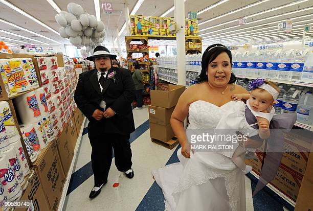 Lesley Barragan and John Tinker walk down food aisles before their 99 cent wedding ceremony at the 99 cent store in Los Angeles on September 9 2009...