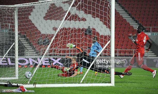 Lesley de Sa of Ajax scores his side's second goal past Danny Ward of Liverpool during the NextGen Series Semi-Final match between Liverpool U19 and...