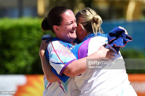 Lesley Doig and Claire Johnston of Scotland celebrate winning the Women's Quarterfinal match against Australia during Lawn Bowls on day eight of the...