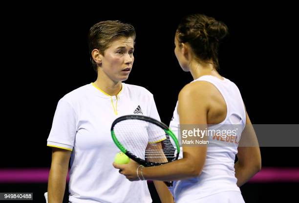 Lesley Kerkhove and Demi Schuurs talk during the doubles match against against Destanee Aiava and Daria Gavrilova of Australia during the World Group...