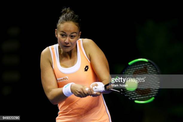 Lesley Kerkhove of the Netherlands plays a backhand in her match against Samantha Stosur of Australia during the World Group PlayOff Fed Cup tie...