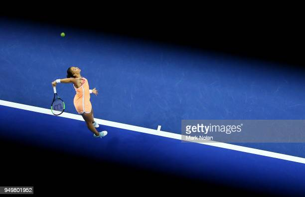 Lesley Kerkhove of the Netherlands serves in her match against Ashleigh Barty of Australia during the World Group PlayOff Fed Cup tie between...
