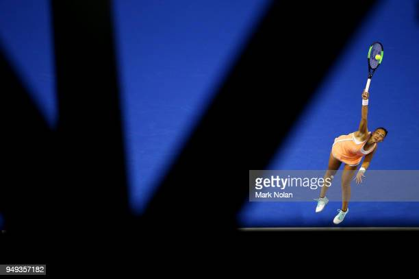Lesley Kerkhove of the Netherlands serves in her match against Samantha Stosur of Australia during the World Group PlayOff Fed Cup tie between...