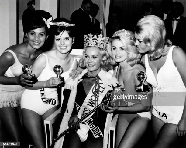 Lesley Langley from England fanked by Miss Tahiti Miss Ireland Miss USA and Miss Austria reacts after being crowned Miss World 1965 on November 20...