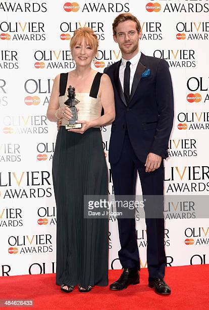 Lesley Manville with her Best Actress award for Ghosts with award presenter Luke Treadaway during the Laurence Olivier Awards at the Royal Opera...