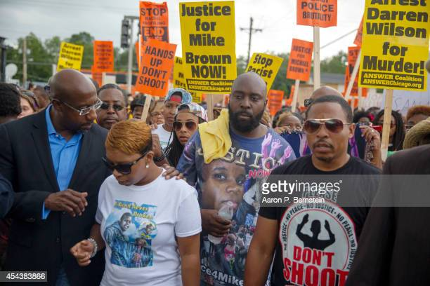 Lesley McSpadden and Michael Brown Sr parents of Michael Brown march in a protest for their son on August 30 2014 in Ferguson Missouri Michael Brown...