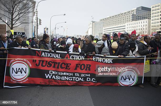 Lesley McSpadden mother of Ferguson shooting victim Michael Brown trips on a banner as Reverend Al Sharpton lead the Justice For All march in...