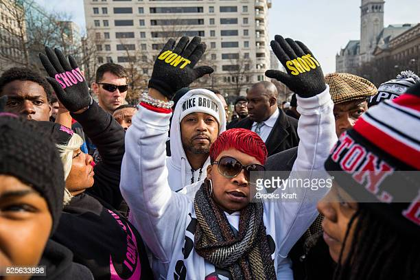 Lesley McSpadden mother of Ferguson shooting victim Michael Brown raises her hands up in the air during the 'Justice For All' rally and march against...