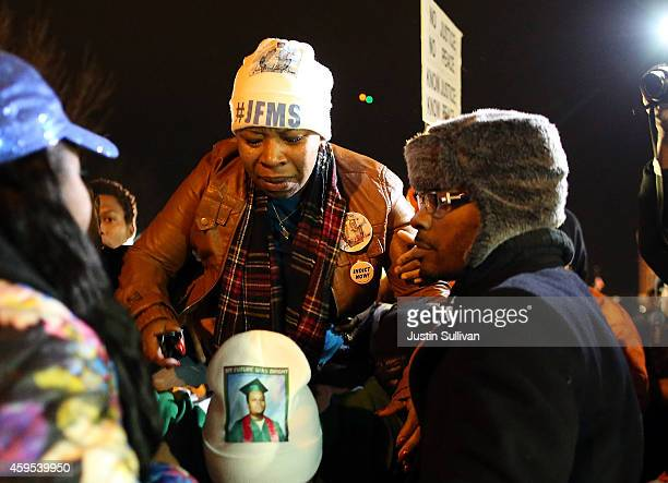 Lesley McSpadden mother of Michael Brown is escorted away from in front of the Ferguson police department after a grand jury's decision was delivered...