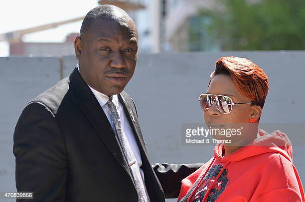 Lesley McSpadden mother of slain 18year old Michael Brown Jr is comforted by the Brown Family attorney Benjamin L Crump after a press conference...